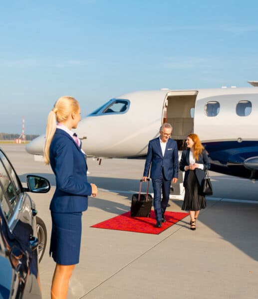 business people leaving private jet
