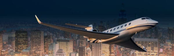 Private jet Flying Over City