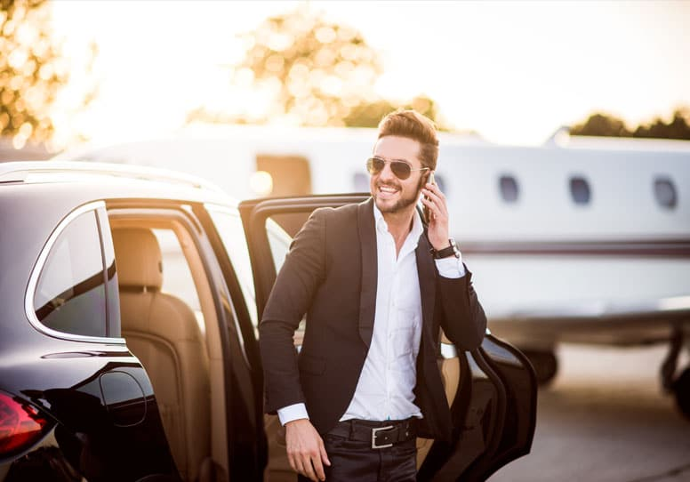 business man boarding private jet