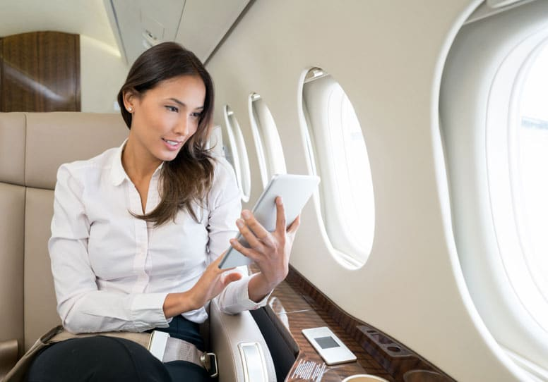 business woman on private jet